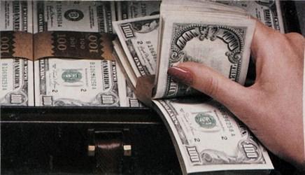 $100 bills in woman's hand