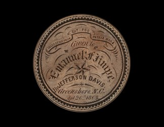 Sounvenir Given to Emmanuel F. Knipe by jefferson Davis, on 1859 silver dollar