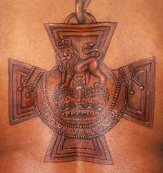 IRAQ VET TATTOOS VICTORIA CROSS MEDAL ON HIS BACK