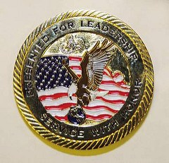 FATHER OF KILLED SERVICEMAN GIVES SON'S CHALLENGE COINS TO OFFICIALS
