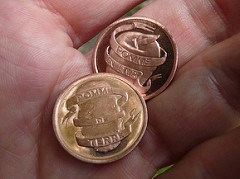 COINS FOR HARD TIMES: ARTIST MAKES HIS OWN MONEY