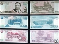 ANGRY NORTH KOREANS BURN BANKNOTES IN PROTEST