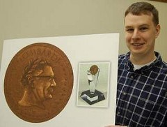 MEDALLION DEPICTS VINCE LOMBARDI AS LAUREL-CROWNED HERO