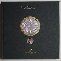 ANOTHER COIN BOOK WITH AN ENCASED COIN OR MEDAL