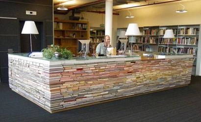A LIBRARY DESK MADE OF BOOKS