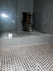 A BATHROOM FLOOR TILED IN NICKELS