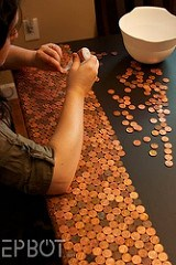 A DESKTOP STUDDED WITH CENTS