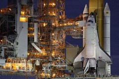 SPACE SHUTTLE DISCOVERY CARRIES MEDAL INTO SPACE