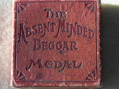 THE BATHING ABSENT MINDED BEGGAR MEDAL