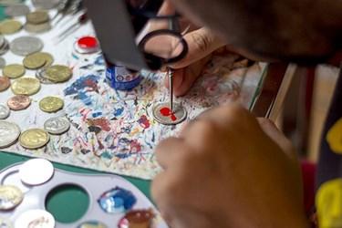 TALES YOU LOSE: ARTIST PAINTS COINS