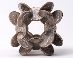 ARTISTS FORMS GEOMETRIC SCULPTURES FROM INTERLOCKED COINS