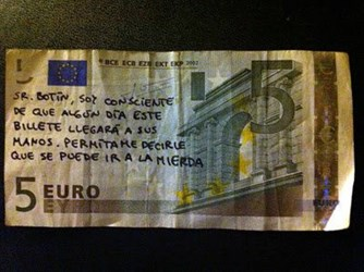 SPANISH PROTESTERS PUTTING COMPLAINTS ON BANKNOTES