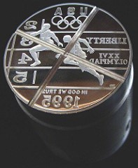 MEDALS STRUCK WITH CANCELLED 1995 OLYMPIC DOLLAR DIE
