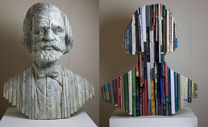 STONE BUSTS CARVED FROM STACKED BOOKS