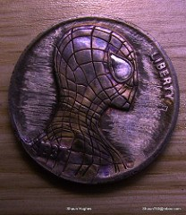 THE COIN-CARVING ART OF SHAUN HUGHES