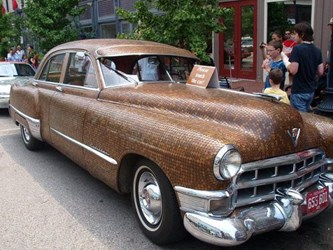 A 1949 CADILLAC COVERED WITH CENTS