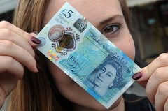 LOW SERIAL NUMBER FIVE POUND NOTES SOUGHT
