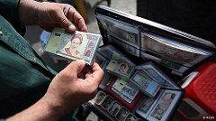 IRAN MAY CHANGE ITS CURRENCY