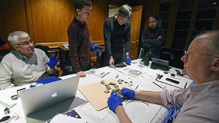 NUMISMATISTS EXAMINE TIME CAPSULE COINS