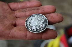 SILVER DOLLAR FOUND UNDER COURTHOUSE COLUMN